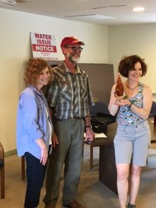 (From left) Sharon, Simons (Chair, Wilderness Ranch Firewise Community Board), Brett VanPaepeghem (IDFW South Project Manager) and Carrie Wiss (Wilderness Ranch resident and former IDFW Board member) accept a 15-year recognition award from Firewise Communities/USA.